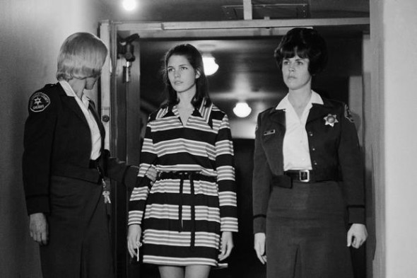 "Leslie Van Houten, pictured here at 19 years old, a member of Charles Manson's ""family"" who was convicted of the murders of Leno and Rosemary LaBianca, is escorted by two deputy sheriffs as she leaves the courtroom in Los Angeles, Dec. 19, 1969 after a brief hearing related to the case."