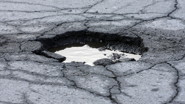 Think that Pot Hole Will Be Fixed Soon? Think Again