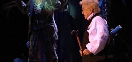 The ghost of Jacob Marley, Scrooge's deceased business partner (Tara Burnett-Doering), confronts Scrooge (Jane McNealy) in the Nine O'Clock Players' production of Mr. Scrooge.
