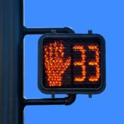 The current jaywalking law, which prohibits crossing on a flashing hand, does not reflect modern crossing signals, which include a countdown.