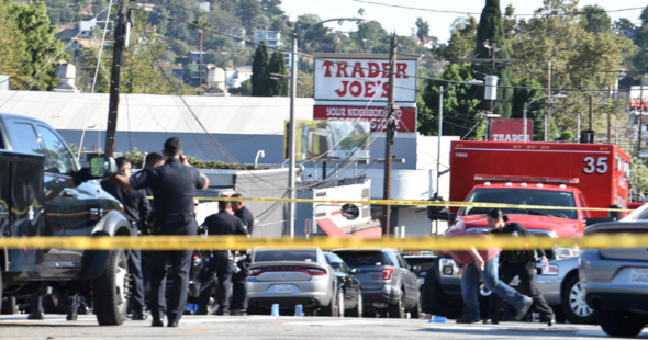 Authorities say 1 killed in LA market standoff
